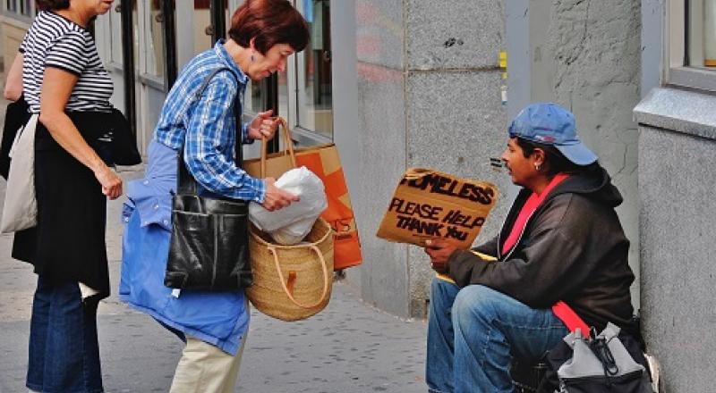 Should Christians give cash to the homeless?