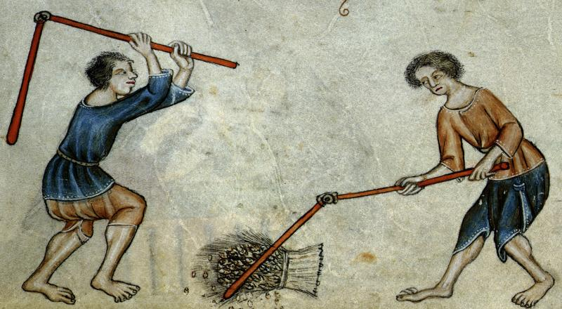 Serfs threshing wheat, from the Luttrell Psalter.
