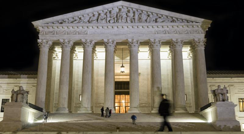 The U.S. Supreme Court at night.